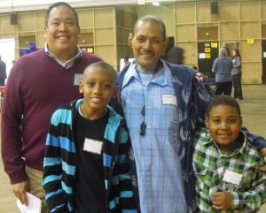 Lyle Monteserrato with a client family at The Family Center Annual Holiday Party 2011